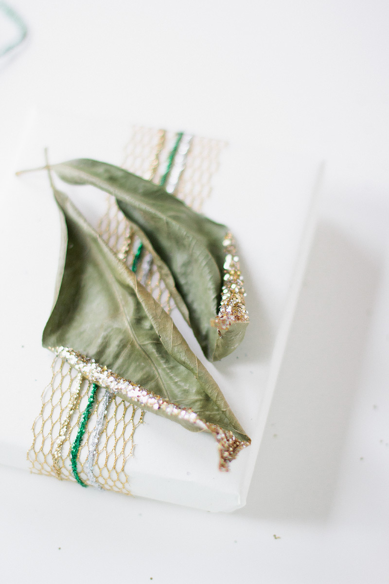 gift wrap: mandarin leaves via ANASTASIA MARIE