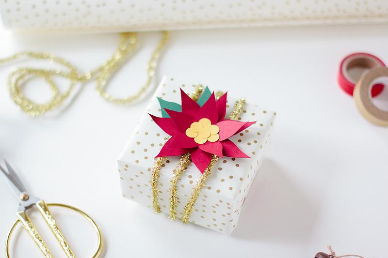 paper poinsettia gift wrap via ANASTASIA MARIE